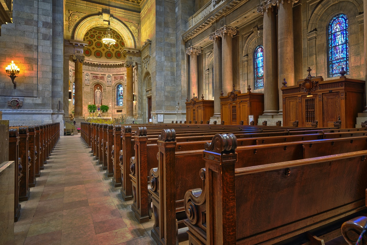 brown-wooden-church-pew-align-facing-the-altar-760111